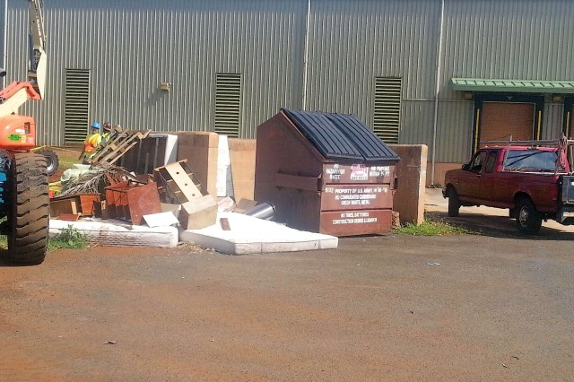 Items such as mattresses, appliances, disassembled entertainment centers and discarded appliances can be placed by dumpsters, like this one by Bldg. 2071, Schofield Barracks, for bulk pick-up at Island Palm Communities.