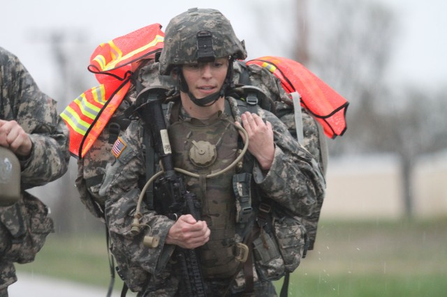 Staff Sgt. Kathleen Briere, 6th Military Intelligence Battalion, 100th Training Division, paces herself during the seven-mile road march portion of the 80th Training Command (TASS) 2013 Best Warrior Competition at Fort Leonard Wood, Mo., April 18, 2013. Briere was the first of the competitors to cross the finish line.