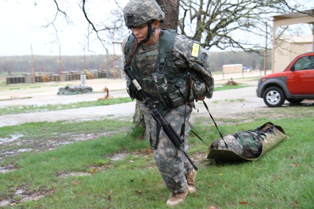 Staff Sgt. Kathleen Briere, 6th Military Intelligence Battalion, 100th Training Division, pulls the 200-pound simulated injured Soldier during the 80th Training Command (TASS) 2013 Best Warrior Competition at Fort Leonard Wood, Mo., April 18, 2013.