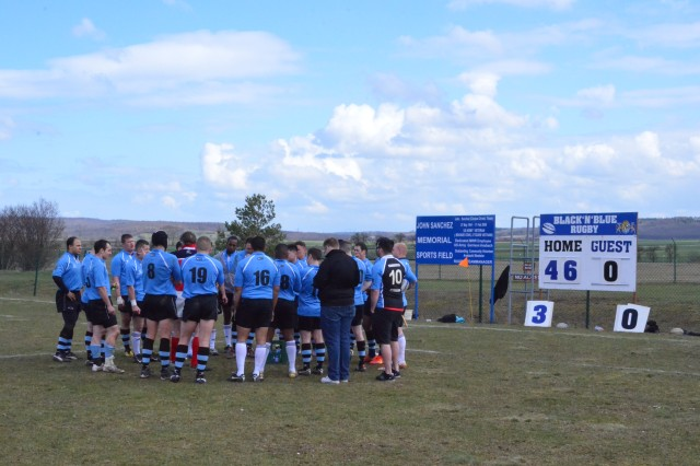 The Black n Blue rugby team, the home team from Storck Barracks, Germany, gathers together during the half break of a game with Wurzburg April 13. Black n Blue eventually won the match 101-0.