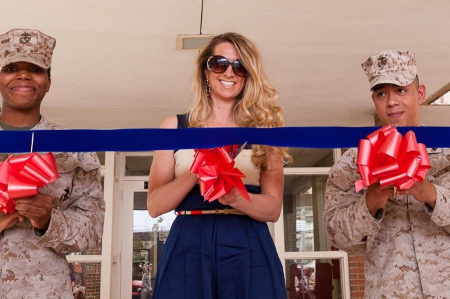 From the left; Distribution Management Office Platoon Sergeant Sgt. Ottheia Searcy, USO Metro Manager of Programs and Services Shalyn Bartelt and Cpl. Michael Zunie, cut the ribbon during the ceremony to open the new Marine Barracks Lounge in Bldg. 416 on the Fort Myer portion of Joint Base Myer-Henderson Hall, Va., April 11, 2013.