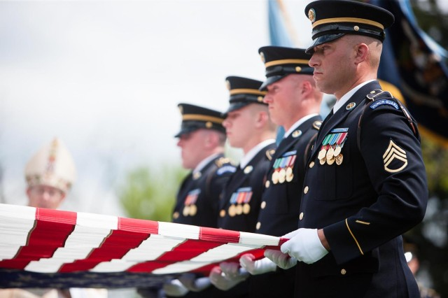 Members of the 3d U.S. Infantry Regiment (The Old Guard) participate in the burial of U.S. Army Lt. Col. Don C. Faith Jr. in Arlington National Cemetery, Va., April 17, 2013. Faith posthumously received the Medal of Honor for his actions during the Korean conflict's battle of Chosin Reservoir.