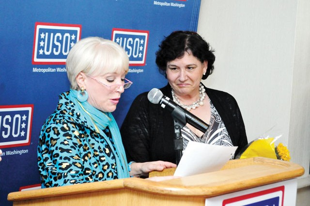 Elaine Rogers, left, USO-Metropolitan Washington president and chief executive officer, recognizes Evi Cox-Jordan, USO-Metro Volunteer, for completing 1,000 hours of volunteer service in a year during the USO- Metropolitan Washington's Annual Celebration of Volunteers ceremony April 13.