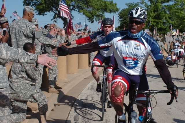 Fort Hood Warrior Transition Brigade Soldiers from 1st Battalion, B Company greet WTB Soldiers,  Sgt. 1st Class Corey Edwards and Sgt. Jacob Ellingson, during the annual Ride 2 Recovery Texas Challenge. The six-day, 350-mile bike ride rolled through Fort Hood April 11. Edwards is a wounded warrior assigned to B Company, and Ellingson is assigned to A Company.  The purpose of the  cycle challenge is to support wounded, ill and injured Soldiers during their rehabilitation and recovery. More than 160 wounded warriors, veterans and supporters participated in the 2013 challenge, which began in San Antonio April 8 and ended in Arlington April 13.