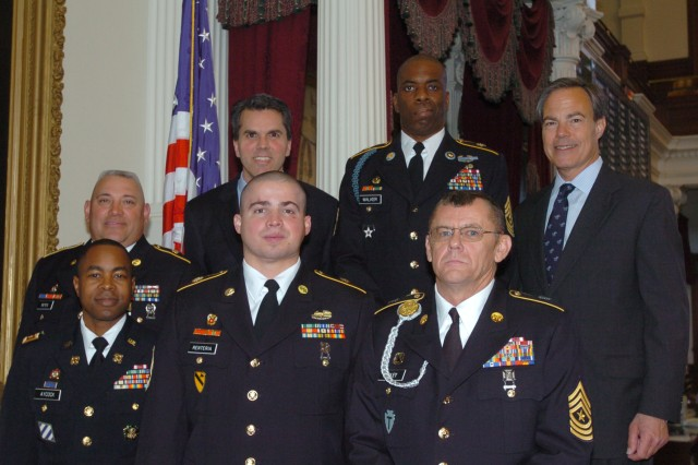 Texas Representative Mark Strama's efforts to honor those who care for the nation's wounded, ill and injured Soldiers resulted in HR 770. Front row from left:  Maj. Edwin Aycock, Sgt. 1st Class David Renteria and Sgt. Maj. Danny Foley. Second row from left: Staff Sgt. Guadalupe Reyes, Strama, 1st Sgt. Raymond Walker and Texas Speaker of the House, Rep.  Joe Straus. Honored, but unable to attend the ceremony, was Isabel Tilzey.