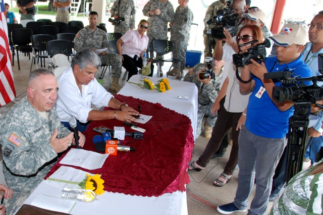 Brig. Gen. Orlando Salinas, U.S. Army South deputy commanding general (left) and José Raúl Mulino, Panamanian public safety minister, take part in a press conference after the opening ceremony for Beyond the Horizon-Panama (BTH) 2013.