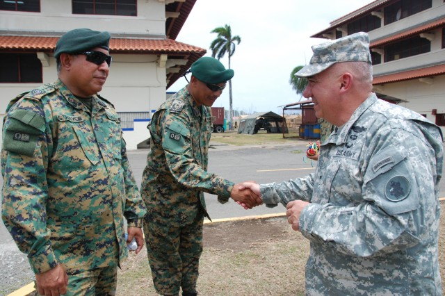 Brig. Gen. Orlando Salinas, U.S. Army South deputy commanding general (right) visits with members of the Panamanian Defense Force before the opening ceremony for Beyond the Horizon-Panama (BTH) 2013.