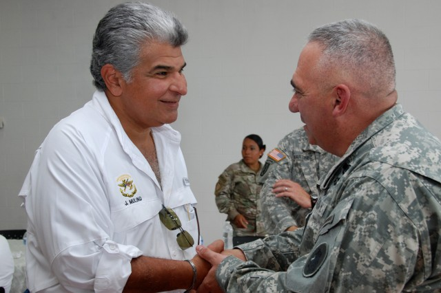 Brig. Gen. Orlando Salinas, U.S. Army South deputy commanding general (right) visits with José Raúl Mulino, Panamanian public safety minister, before the opening ceremony for Beyond the Horizon-Panama (BTH) 2013.