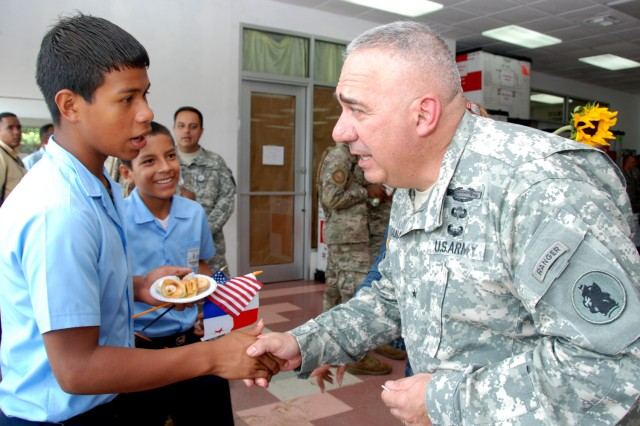 Brig. Gen. Orlando Salinas, U.S. Army South deputy commanding general (right) visits with Panamanian school children after an opening ceremony for Beyond the Horizon-Panama (BTH) 2013.