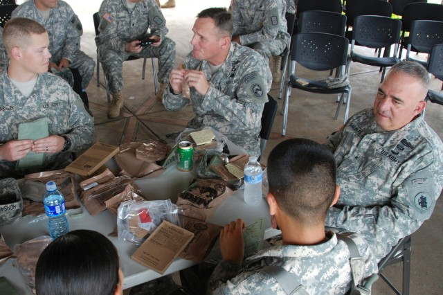 Brig. Gen. Orlando Salinas, U.S. Army South deputy commanding general (right) and Command Sgt. Maj. William B. Zaiser, U.S. Southern Command senior enlisted advisor (center) have lunch with Soldiers here April 17 during Beyond the Horizon-Panama (BTH) 2013.