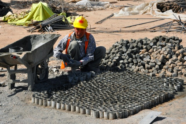 A construction worker organizes spacing devices April 17 that will be used in construction of the future installation for the 3rd Brigade, 205th Corps Afghan National Army in Zhari district.