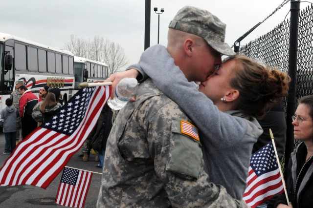 READING, Pa. (April 16, 2013) - A U.S. Army Reserve Soldier, bound for Afghanistan, says goodbye minutes before boarding the bus for Fort Bliss. Approximately 150 Army Reservists with 333rd Engineer Company, 365th Engineer Battalion, 411th Engineer Brigade, 412th Theater Engineer Command, are heading to the Middle East in support of Operation Enduring Freedom.