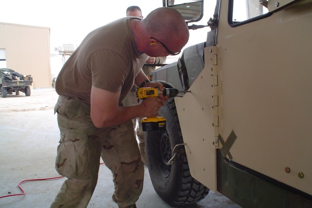Armor Survivability Kits are being installed on Humvees at Camp Udari, Iraq.