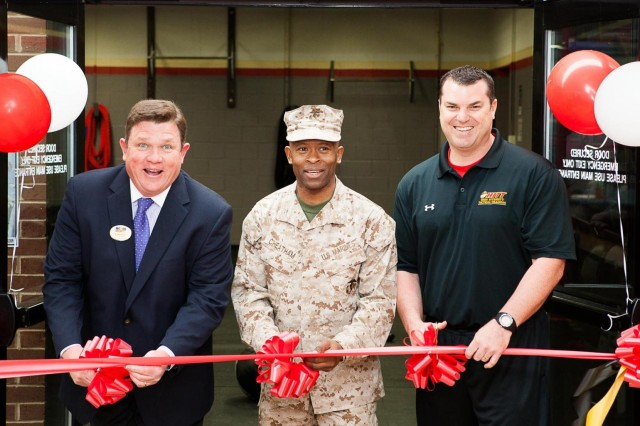 Marine Corps Community Services Director Roger Weger; Headquarters and Service Battalion, Headquarters Marine Corps, Henderson Hall Commanding Officer Col. Ira M. Cheatham and Combat Fitness Program Manager Ryan Massimo cut the ribbon during the opening ceremony of the High Intensity Tactical Training center in the Cpl. Terry L. Smith Gymnasium on the Henderson Hall portion of Joint Base Myer-Henderson Hall, Va., April 15, 2013.
