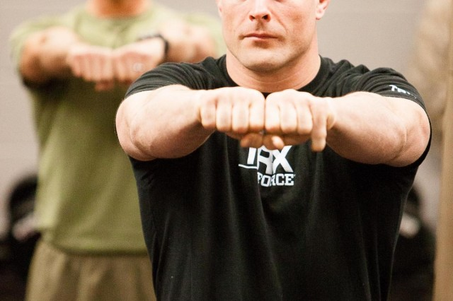 Brian Stann, former Marine Corps captain and professional Ultimate Fighting Challenge athlete, and Marines from Headquarters and Service Battalion, Headquarters Marine Corps, Henderson Hall demonstrate some of the High Intensity Tactical Training exercises during the opening ceremony of the HITT center in the Cpl. Terry L. Smith Gymnasium on the Henderson Hall portion of Joint Base Myer-Henderson Hall, Va., April 15, 2013.