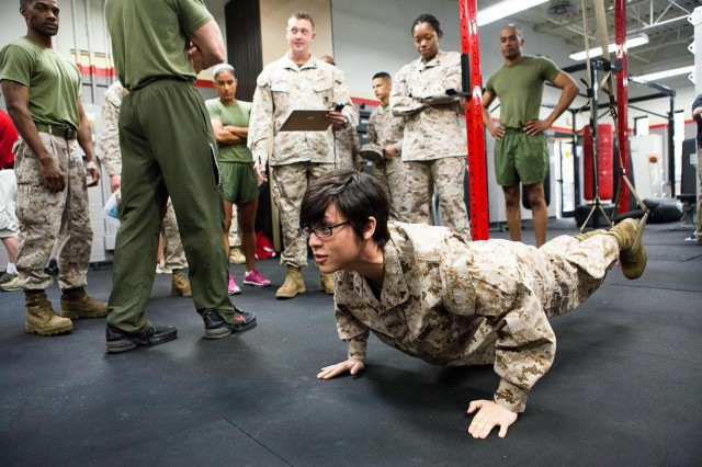 Lance Cpl. Kim Maldonado-Cruz tries one of the High Intensity Tactical Training center exercises after the opening ceremony of the HITT center in the Cpl. Terry L. Smith Gymnasium on the Henderson Hall portion of Joint Base Myer-Henderson Hall, Va., April 15, 2013. (Joint Base Myer-Henderson Hall PAO Photo by Rachel Larue)