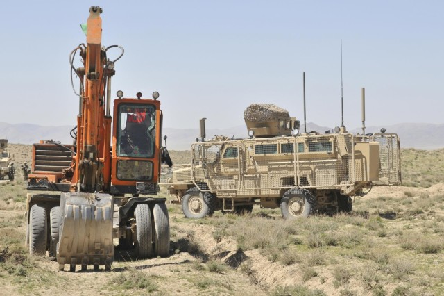 A route clearance vehicle with the 591st Engineer Company provides security for earthmoving equipment being used to construct a new Afghan Border Police checkpoint in the Spin Boldak district of Kandahar province, Afghanistan, March 25, 2013. The checkpoint was built to block an insurgent infiltration route near the Afghanistan-Pakistan border.  (U.S. Army photo by Staff Sgt. Shane Hamann/Released)