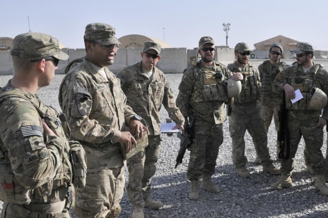 U.S. Soldiers with the Texas National Guard brief their Albanian special operations forces counterparts before conducting a checkpoint assessment near the Afghanistan-Pakistan border in the Spin Boldak district of Kandahar province, Afghanistan, April 1, 2013. The checkpoint was built to block an insurgent infiltration route.  (U.S. Army photo by Staff Sgt. Shane Hamann/Released)