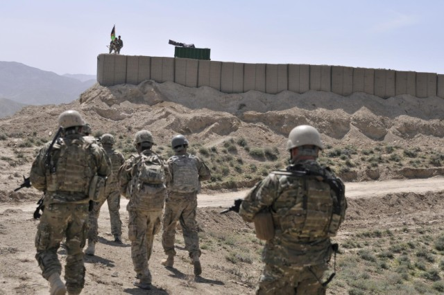 U.S. and Albanian special operations forces approach an Afghan Border Police checkpoint overlooking a mountain pass near the Afghanistan-Pakistan border in the Spin Boldak district of Kandahar province, Afghanistan, April 1, 2013. The checkpoint was built to block an insurgent infiltration route.  (U.S. Army photo by Staff Sgt. Shane Hamann/Released)