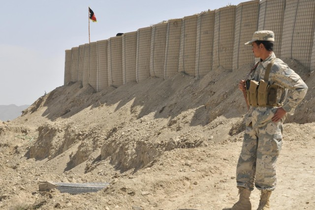 An Afghan Border Policeman stands watch near the entrance to a new checkpoint overlooking a mountain pass near the Afghanistan-Pakistan border in the Spin Boldak district of Kandahar province, Afghanistan, April 1, 2013. The checkpoint was built to block an insurgent infiltration route.  (U.S. Army photo by Staff Sgt. Shane Hamann/Released)