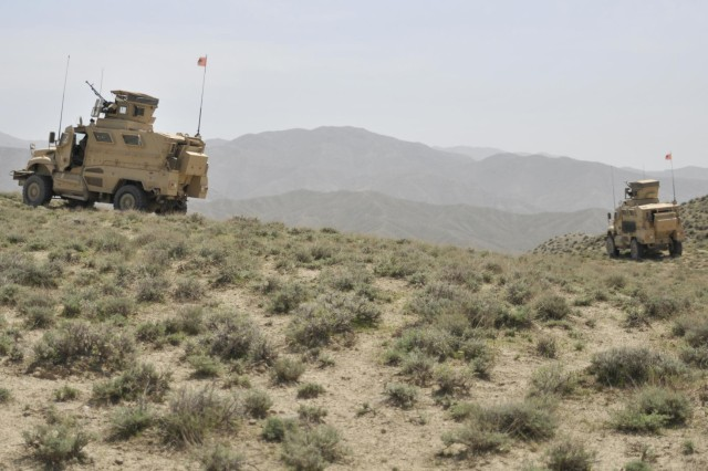 Mine-resistant, ambush-protected vehicles assigned to the Albanian special operations forces provide security for coalition forces at an Afghan Border Police checkpoint near the Afghanistan-Pakistan border in the Spin Boldak district of Kandahar province, Afghanistan, April 1, 2013.  (U.S. Army photo by Staff Sgt. Shane Hamann/Released)