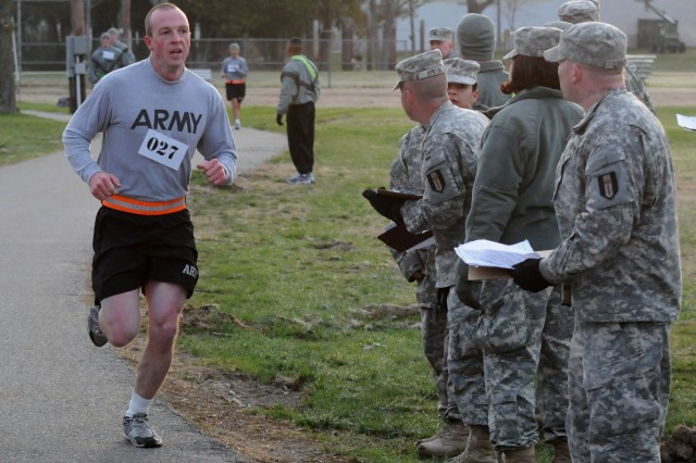 Spc. Steven Taulbee, 450th Engineer Company, 478th Engineer Battalion, 926th Engineer Brigade, crosses the finish line with the fastest time during the Army Physical Fitness Test on day two of the 412th Theater Engineer Command's 2013 Best Warrior Competition held at Fort Devens, Mass. April 22.