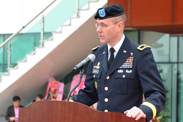 Eighth Army Deputy Commanding General for Sustainment Brig. Gen. Chris R. Gentry speaks at the opening ceremony for the memorial hall, at Osan, South Korea, April 23, 2013.