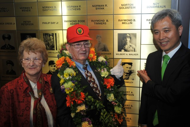Together with Osan Mayor Kwak Sang-wook and his wife Martha, Task Force Smith Veteran Wilbert A. Walker (center) stands beside his name inside the memorial hall, April 23, 2013, at Osan, South Korea.