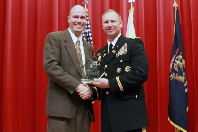 Michael Kolar, left, is presented the 2012 Gen. William E. DePuy Award April 16 by Lt. Col. Jeff McDonald, the professor of military science at Michigan State University. Photo submitted