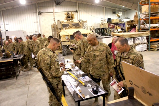 RDECOM Field Assistance in Science and Technology-Center, or RFAST-C, engineers and technicians discuss prototype integration facility capabilities with senior noncommissioned officers from the 18th Engineer Brigade at Bagram Airfield, Afghanistan, in June 2012.