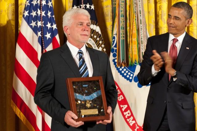 President Barack Obama awarded the Medal of Honor posthumously to Army chaplain (Capt.) Emil J. Kapaun at the White House, April 11, 2013. Here, Kapaun's nephew, Ray Kapaun, accepts it on his behalf.