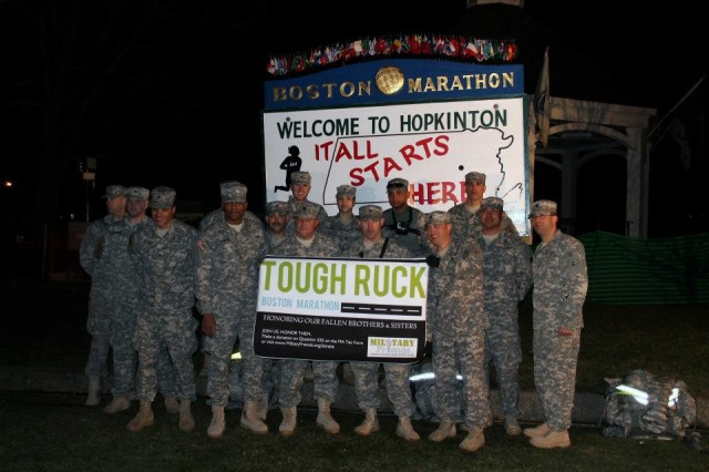 "Massachusetts National Guard Soldiers pose in Hopkinton, Mass., April 15, 2013, prior to their ""Tough Ruck"" walk at the Boston Marathon. Some of the Soldiers helped bombing victims at the race finish line."