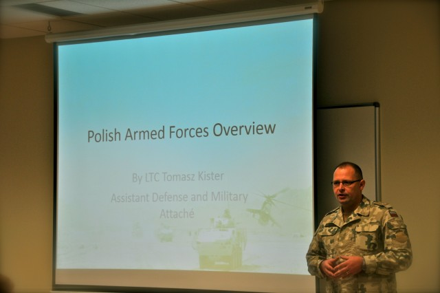 Lt. Col. Tomasz Kister, the Assistant Defense and Military Attaché at the Polish Embassy in Washington D.C., talks to members of Provincial Reconstruction Team Ghazni about Poland during a cultural brief at Camp Atterbury, Ind.