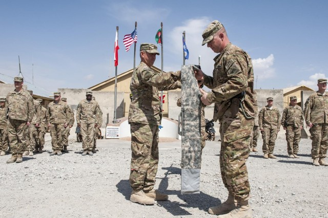 U.S. Army Col. Terry Cook the commanding officer of the 4th Brigade Combat Team, 1st Armored Division, and Sgt. Maj. Frank Wilson, the senior enlisted adviser, prepare the brigade's colors for transport during a casing of the colors ceremony at Forward Operating Base Lightning in  Paktya province, Afghanistan, April 21, 2013.  (U.S. Army National Guard photo by Spc. Ryan Scott/Released)
