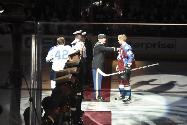 Col. David Grosso, U.S. Army Garrison Fort Carson commander, thanks Colorado Avalanche captain Gabe Landeskog following the ceremonial puck drop between the two teams' captains during the second annual Military Appreciation Night at the Pepsi Center in Denver, April 21, 2013. The ceremonial puck drop is similar to the first pitch in baseball. The Colorado Avalanche had five service members from each branch of the military stand on the red carpet to honor them during the pregame show. The Colorado Avalanche were victorious defeating the St. Louis Blues, with as score of 5-3.