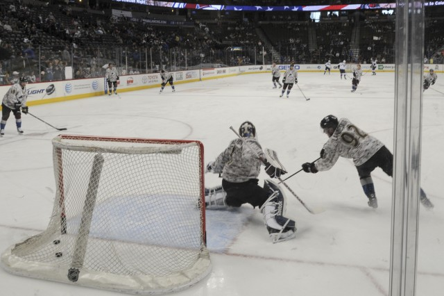 The Colorado Avalanche warm-up in their camouflage jerseys during the second annual Military Appreciation Night at the Pepsi Center in Denver, April 21, 2013. The jerseys were auctioned off to benefit Kroenke Sports Charities, which supports numerous agencies including the military. The Colorado Avalanche were victorious defeating the St. Louis Blues, with as score of 5-3.