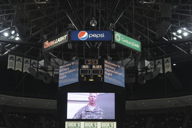 Lt. Dan Jernigan, with 1st Battalion, 22nd Infantry Regiment, 1st Armor Brigade Combat Team, 4th Infantry Division, on the Jumbotron giving a shout-out to his family that was at the game. Jernigan was one of eight deployed Fort Carson, Colo., Soldier shout-out videos played during the Colorado Avalanche's second annual Military Appreciation Night in Denver, April 21, 2013. The Colorado Avalanche were victorious defeating the St. Louis Blues, with as score of 5-3.