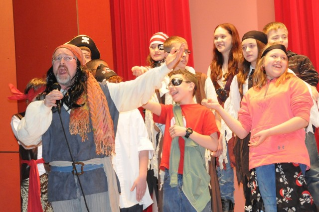 Pirate King Chris Hite sings along with his band of scallywags during the HES 6th grade musical.