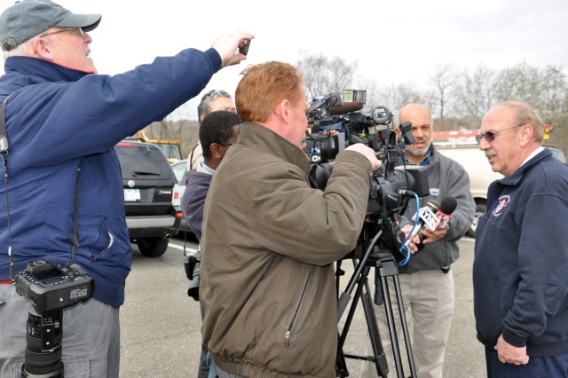 Schenectady County Fire Coordinator John Nuzback, right, providing a situation update to the local media.  TV affiliates from ABC news, NBC news, CBS news, and from Time Warner's YourNewsNow covered the event, as well as representatives from the Times Union and Troy Record newspapers.