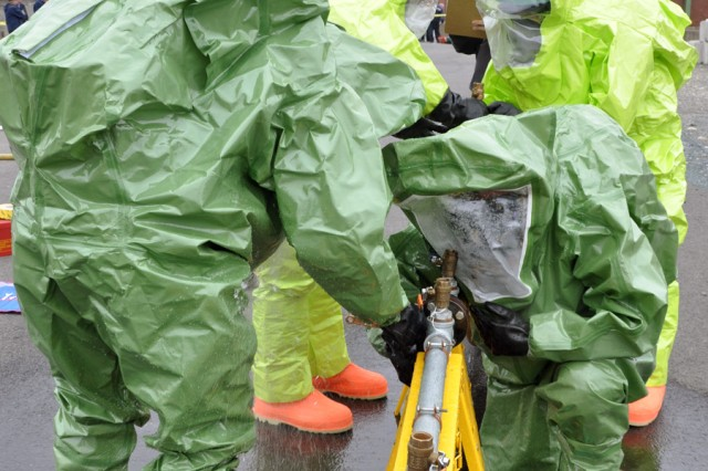HAZMAT teams from two agencies attempt to close a simulated sulfur dioxide leak.