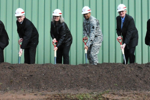 From left: Andreas Schepers, Norbel Hoebel, Donna L. Street, Maj. Gen. Aundre F. Piggee, Helmut Haufe and Paul Lindemeber dig the first shovels of dirt for the Theater Logistics Support Center Europe fuel purging station at the Kaiserslautern Army Depot, April 12.