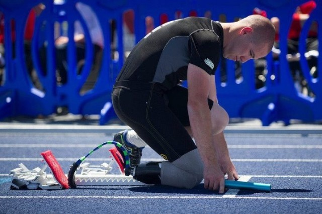 Sgt. Ryan McIntosh gets ready to compete in the track competition during the 2012 Army Warrior Games in Colorado. He took home the gold medal in wheelchair basketball, silver medals in two track events, and a bronze medal in swimming.