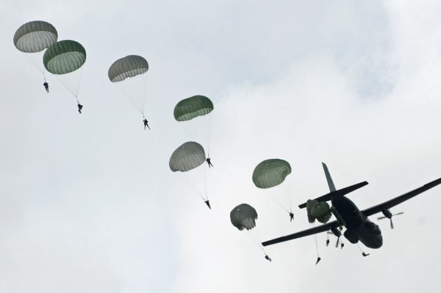 Paratroopers with the 82nd Airborne Division's 1st Brigade Combat Team exit a German C-160 Transall airplane above Normandy Drop Zone, April 18, 2013, during Operation Federal Eagle on Fort Bragg, N.C. More than 200 Devil brigade paratroopers earned their German wings throughout the course of the annual joint airborne operation.