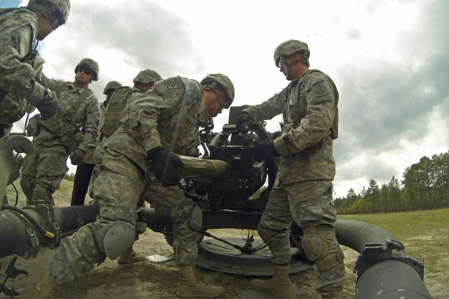 Artillerymen with 3rd Battalion, 319th Airborne Field Artillery Regiment, 1st Brigade Combat Team, 82nd Airborne Division, load a round into the Army's new all-digital M119A3 105 mm lightweight howitzer, April 19, on Fort Bragg, N.C. The Gun Devils made history by being the first operational unit in the Army to field and fire the weapon system.