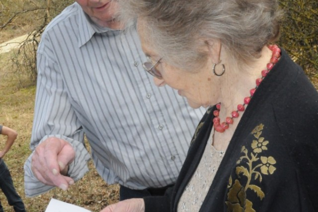 Paulina Carman and fellow former Bergheim resident Franz Katzhammer study a photo of Carman's old homestead from the very spot where the farm once stood.