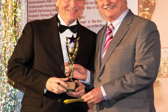 Larry Kreider (left) receives an award for best supporting actor in a musical at the Toppers award for best Musical April 20.