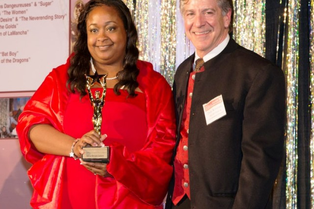 Alicia Bryant-James (left) receives an award for Best Featured Actress in a Minor Role in a Musical at the Toppers award for best Musical April 20.