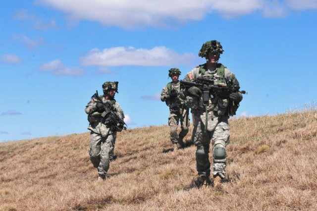 Soldiers with 3rd Squadron, 71st Cavalry Regiment, 3rd Brigade Combat Team, conduct tactical movement techniques during a patrol at Mountain Peak. The exercise served to validate the 3rd BCT before its culminating training experience this summer at the Joint Readiness Training Center, Fort Polk, La.