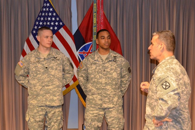 Command Sgt. Maj. Rick Merritt, right, 10th Mountain Division (LI) senior enlisted adviser, congratulates Staff Sgt. Jason Selvon and Spc. Derek J. Probizanski during an awards ceremony for the 10th Mountain Division (LI) NCO of the Year and Soldier of the Year.