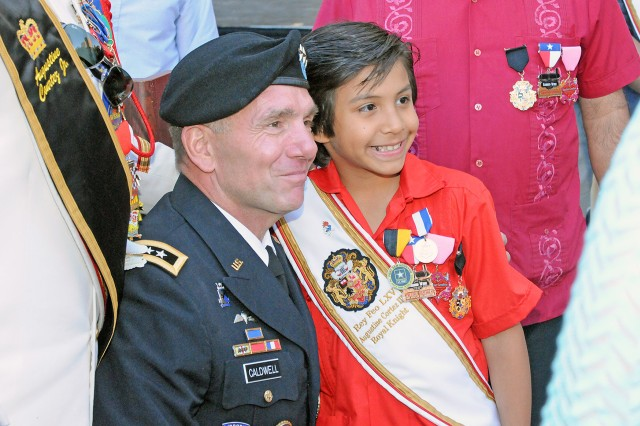 "SAN ANTONIO "" Lt. Gen. William Caldwell IV shares a moment with Auggie Cortez III, 8, one of the royal knights of the court of El Rey Feo in front of the San Fernando Cathedral downtown April 19 following the crowning of El Rey Feo LXV. Caldwell is the commanding general of U.S. Army North (Fifth Army) and senior commander of Fort Sam Houston and Camp Bullis. The crowning is just one of many official Fiesta San Antonio events."